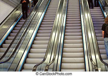 people on escalators in a department store