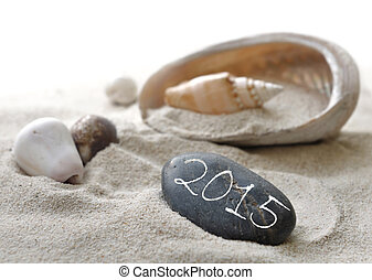 new year 2015 on pebble - 2015 on a pebble in the sand among...