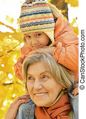 Grandmother with granddaughter in park - Grandmother with...