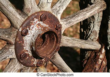 Rusty wagon wheel  - Close up of an old rusty wagon wheel.
