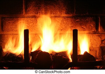 Fireplace - Flames light up the warm scene of a fireplace....
