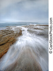 Misty fog and ocean chasm flows - Misty fog hide the sky and...
