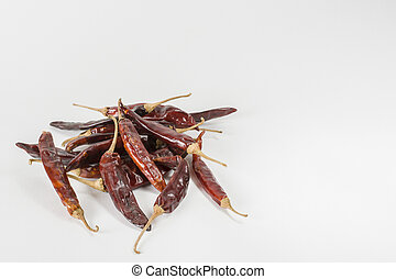Dry red Indian chillies on a white background