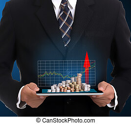 Businessman holding touch pad and growing finance for show...