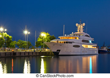 Luxury yacht in the port at night