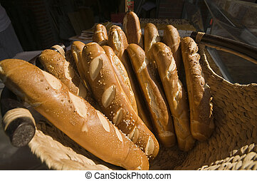 salted baguettes - bunch of salted baguettes in a basket