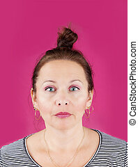 Neutral face woman on pink - Portrait of neutral face middle...