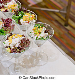 Appetizing salad in a transparent salad bowl, food closeup