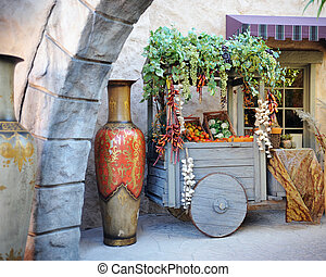Marketplace Produce - An ancient wooden cart filled with...