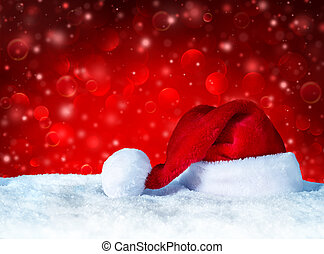 Santa Claus hat with snow and red snowfall background