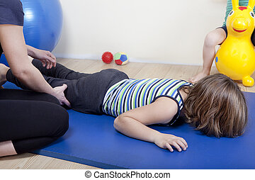 physiotherapy leg workout - a female physiotherapist makes...