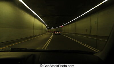 Montreal tunnel - Driving through a tunnel lit with green...