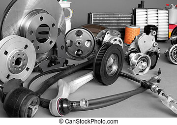 Auto parts - New car parts on a gray background closeup