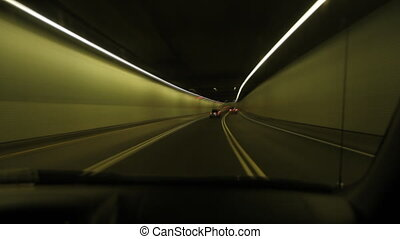 Montreal timelapse tunnel - Driving through a tunnel lit...