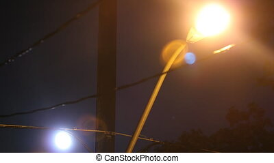 Streetlight and moon timelapse - Timelapse of moon with...