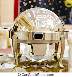 closeup of chafing dishes at a party