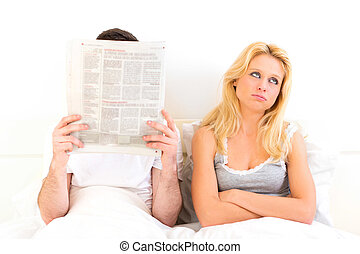Young woman bored while her boy reading news - View of a...