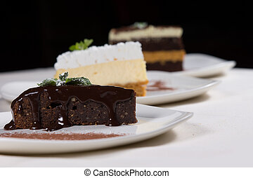 Assorted desserts in a bakery or restaurant with individual...