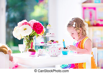 Little girl playing with dolls - Adorable toddler girl with...
