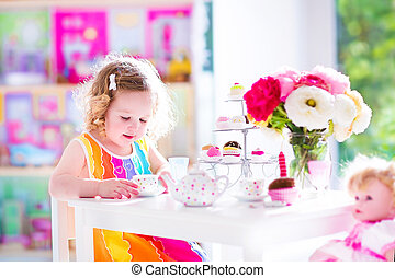 Little girl at tea party - Adorable toddler girl with curly...