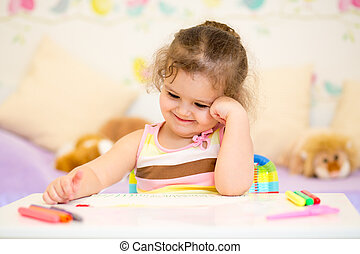 child girl drawing in nursery