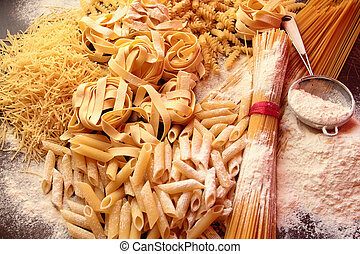Types and shapes of italian pasta with white flour