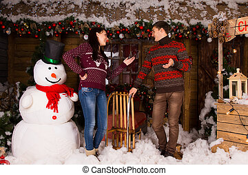 Talking Couple Surrounded with Christmas Decors