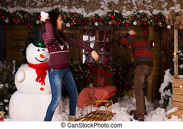 Couple Playing Inside the House with Cotton Snow