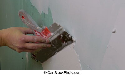 Construction Worker Applying Plaster on a Drywall