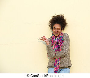 Beautiful african american woman pointing finger - Portrait...