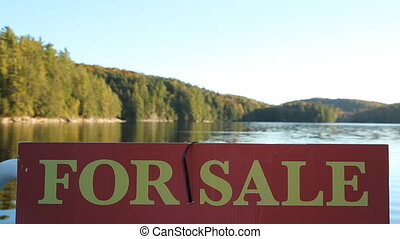 Nature for Sale. - For Sale sign with defocused lake in the...