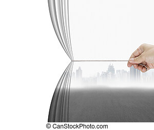 hand pulling gray cityscape curtain revealing empty blank...