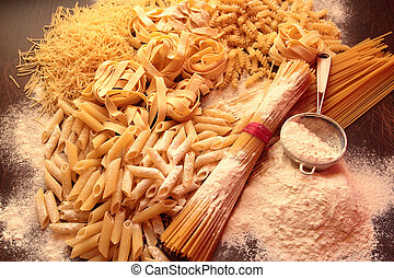 Mixed of shapes and types of pasta with flour