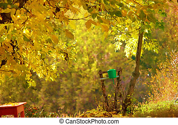 Washstand under an autumn tree with turning yellow leaves