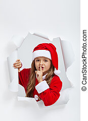 Little girl in christmas outfit telling you a secret