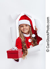 Opening the holidays season - little girl offering you a present