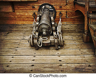 Vintage gun on ancient ship - Antique gun ready to fire on...