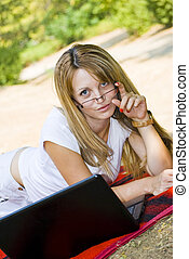 beautiful young woman with laptop - beautiful young woman...