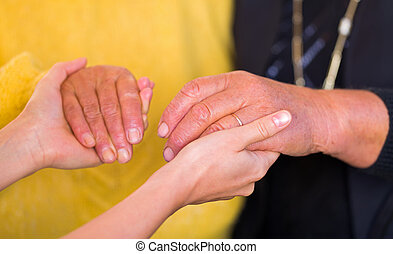 Helping hands - Close up photo of elderly women hand hold by...