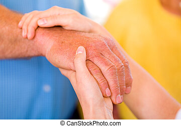 Helping hands - Close up photo of elderly woman hand hold by...