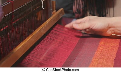 Loom weaving - Weaver working on the loom