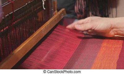 Loom weaving - Weaver working on the loom