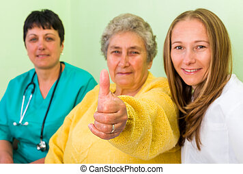 Health insurance - Elderly woman with her carer and doctor