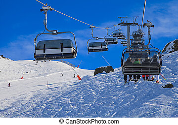Ski lift - Snowy winter landscape and ski lift in the Alps