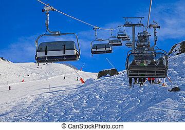 Ski lift - Snowy winter landscape and ski lift in the Alps