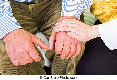 Helping hand - Close up photo of elderly man hands and young...