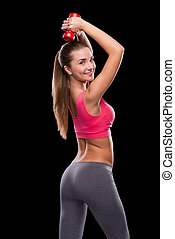 Fit and beautiful Rear view of sporty young woman exercising...