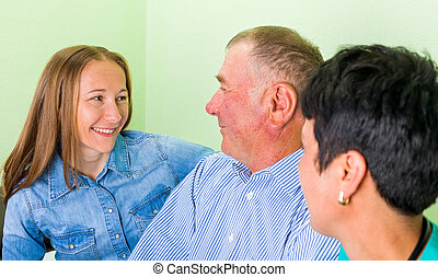 Elderly home care - Photo of an old man with his daughters
