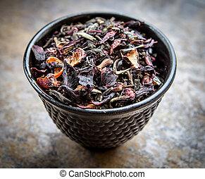Cup Of Loose Leaf Tea On Slate Background