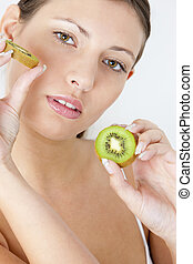 portrait of young woman with kiwi